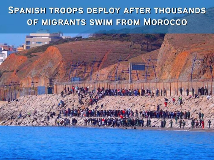 spanish troops deploy after thousands of migrants swim from morocco n.