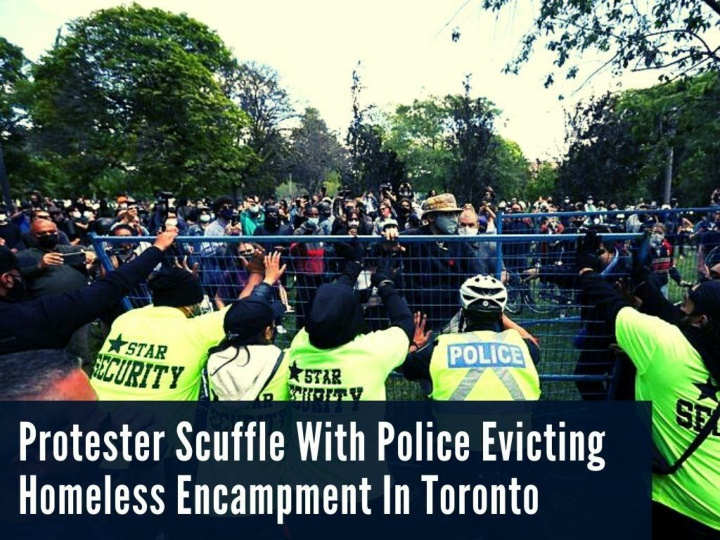 protesters scuffle with police evicting homeless encampment in toronto n.